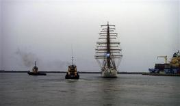 The Argentine naval vessel ARA Libertad is tugged out of Tema harbour in Accra December 19, 2012. The Argentine naval vessel detained in Ghana at the request of a hedge fund seeking payment on defaulted government bonds left the West African country on Wednesday, a port official said. The ARA Libertad, a tall sailing ship used for training, was detained on a court order obtained by NML Capital Ltd, which claims it is owed $300 million from Argentina's default in 2002. REUTERS/Presidencia/Handout