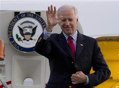 U.S. Vice President Joe Biden waves as he arrives at the Benito Juarez International airport in Mexico City, November 30, 2012. REUTERS/Eduardo Verdugo/Pool