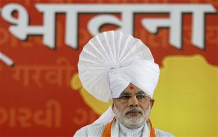Gujarat's Chief Minister Narendra Modi wears a turban as he sits on the first day of his fast at a convention centre in Ahmedabad September 17, 2011. REUTERS/Amit Dave/Files