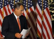 House Speaker John Boehner departs after making a brief statement to the media at the Capitol in Washington December 19, 2012. REUTERS/Gary Cameron