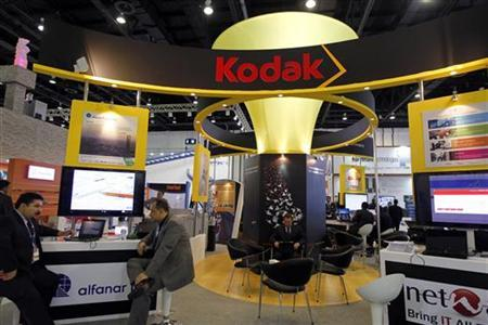 Exhibitors sit at the Kodak stand during the Gulf Information and Technology Exhibition (GITEX) at the Dubai World Trade Centre in Dubai October 14, 2012. REUTERS/Jumana ElHeloueh