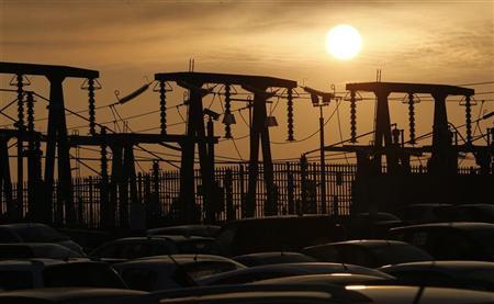 The sun sets behind transformers at EDF Energy's Hinkley Point B nuclear power station in Bridgwater, southwest England December 13, 2012. REUTERS/Suzanne Plunkett