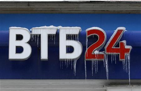 A sign displaying the logotype of VTB Bank, covered with icicles, is seen above the bank office in central Moscow February 27, 2012. REUTERS/Sergei Karpukhin
