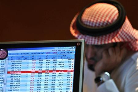 A Saudi trader monitors stocks at the Saudi Bank in Riyadh November 22, 2008. REUTERS/Fahad Shadeed/Files