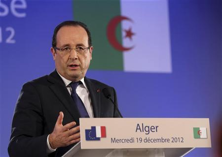 French President Francois Hollande speaks during a news conference in Algiers December 19, 2012. REUTERS/Philippe Wojazer