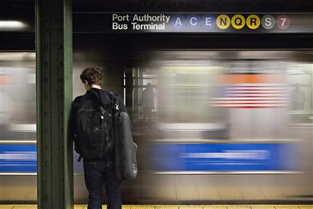 A man waits for the subway at the Times Square stop in New York, December 19, 2012. REUTERS/Andrew Burton
