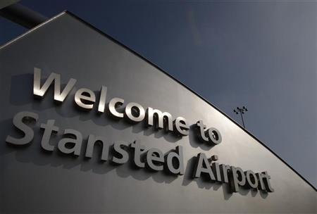 A sign is seen outside Stansted Airport in Essex, southern England March 19, 2009. REUTERS/Stephen Hird