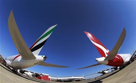 Emirates and Qantas A380 aircraft sit on the tarmac at Kingsford Smith international airport in Sydney September 6, 2012. REUTERS/Daniel Munoz