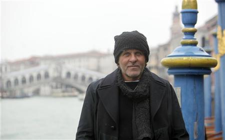Founder of Diesel clothing company Renzo Rosso poses in front of Rialto Bridge in Venice December 14, 2012. REUTERS/Manuel Silvestri