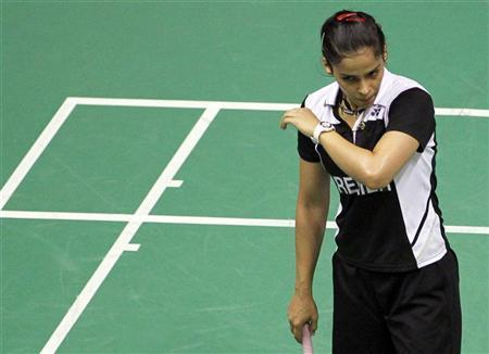 India's Saina Nehwal reacts after being defeated by China's Wang Shixian during their women's single quarter final match at the 2010 Badminton World Championships at the Coubertin stadium in Paris, August 27, 2010. REUTERS/Regis Duvignau