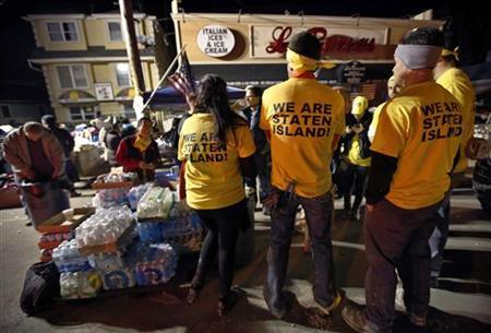 Volunteers gather near an aid and relief station where supplies for victims of Hurricane Sandy are available on Midland Avenue in the Midland Beach neighborhood of Staten Island, New York, November 16, 2012. REUTERS/Mike Segar