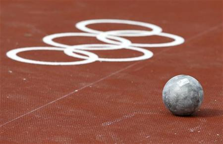 A shot put is seen on the ground during the men's shot put qualification at the London 2012 Olympic Games in the Olympic Stadium August 3, 2012. REUTERS/Kai Pfaffenbach/Files