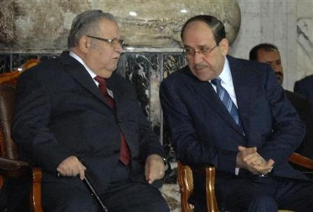 Iraq's President Jalal Talabani (L) talks to Iraq's Prime Minister Nuri al-Maliki during one of several planned ceremonies to mark the end of U.S. military presence in Iraq at Baghdad, December 1, 2011. REUTERS/Iraqi Government/Handout