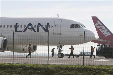 File photo of Brazil's TAM and Chile's LAN airlines' aircraft seen parked at Santiago's International Airport, June 22, 2012. REUTERS/Carlos Vera
