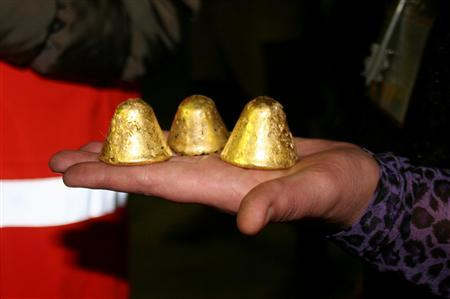 A GV Gold worker holds out gold dore nuggets produced at the Golets Vysochaishy mine in eastern Siberia September 28, 2012. Each piece weighs 300-400g. REUTERS/Clara Ferreira Marques