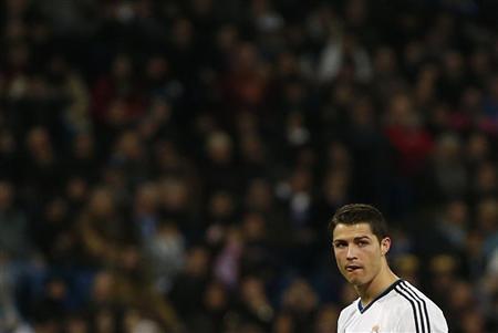Real Madrid's Cristiano Ronaldo looks on during their Spanish First Division soccer match against Espanyol at Santiago Bernabeu Stadium in Madrid December 16, 2012. REUTERS/Juan Medina