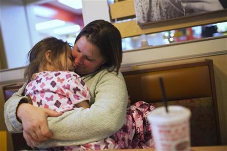 Brandi Burnau holds her niece Sabrina at a restaurant in Indianapolis, Indiana, November 29, 2012. Picture taken November 29, 2012. REUTERS/Aaron P. Bernstein