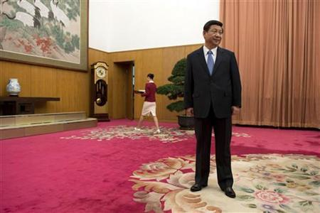 Leader of the Chinese Communist Party Xi Jinping waits to greet former U.S. President Jimmy Carter in room 202 of the Zhongnanhai leadership compound in Beijing December 13, 2012. REUTERS/Ed Jones/Pool