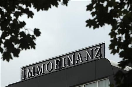 The logo of Austrian real estate group Immofinanz is pictured on top of the company's headquarters building in Vienna August 13, 2010. REUTERS/Heinz-Peter Bader