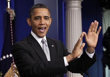 U.S. President Barack Obama gestures as he speaks to the media about the ''fiscal cliff'' in the White House Briefing Room in Washington December 19, 2012. REUTERS/Yuri Gripas