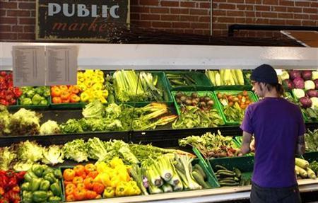 A customer looks over produce at the Phoenix Public Market in Phoenix, Arizona August 23, 2011. REUTERS/Joshua Lott