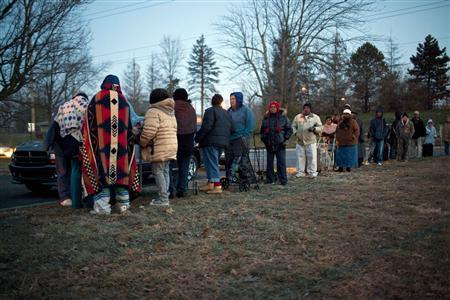 Clients wait in line in the early morning outside the St. Vincent de Paul food pantry in Indianapolis, Indiana, November 27, 2012. REUTERS/Aaron P. Bernstein