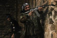 Free Syrian Army fighters take their positions as one of them fires during clashes with forces loyal to Syria's President Bashar al-Assad in Qastal Harami area in Aleppo in this picture released December 19, 2012. Picture released December 19, 2012. REUTERS/Saad Al-Jabri