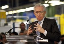 Italy's Prime Minister Mario Monti (C) gestures as he makes his speech during a visit to the Fiat car factory in the southern city of Melfi December 20, 2012. REUTERS/Ciro De Luca