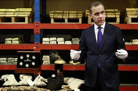 Bank of Canada Governor Mark Carney views some historic gold coins dating back to before World War I, at the Royal Canadian Mint in Ottawa November 28, 2012. REUTERS/Blair Gable