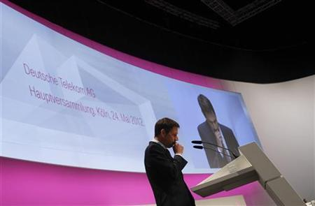 Rene Obermann, chief executive of Deutsche Telekom AG, addresses the company's general shareholders meeting in Cologne May 24, 2012. REUTERS/Wolfgang Rattay (GERMANY - Tags: BUSINESS TELECOMS)