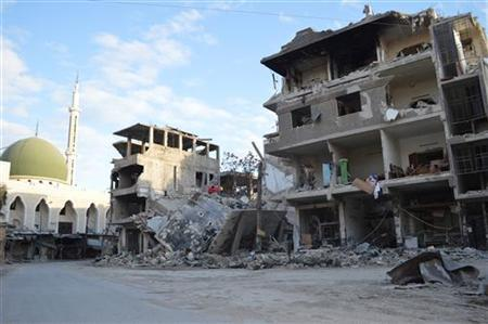 Buildings damaged by what activists said were missiles fired by a Syrian Air Force fighter jet of forces loyal to Syria's President Bashar al-Assad, are pictured at Zamalka near Damascus December 19, 2012. Picture taken December 19, 2012. REUTERS/Karm Seif/Shaam News Network/Handout