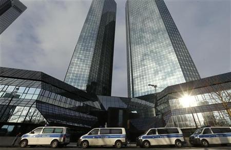 Police vehicles are parked outside the headquarters of Germany's largest business bank, Deutsche Bank AG in Frankfurt December 12, 2012. REUTERS/Kai Pfaffenbach (GERMANY - Tags: BUSINESS CRIME LAW)