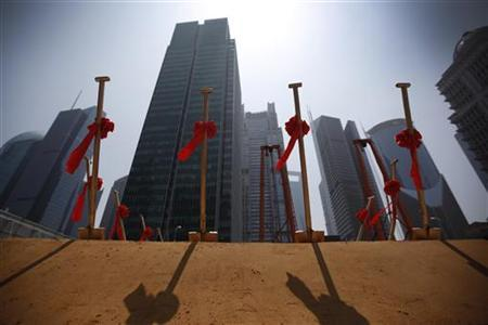 Shovels are seen at a ground breaking ceremony for Foxconn's new China headquarters building at the Lujiazui financial district of Pudong in Shanghai May 10, 2012. REUTERS/Aly Song