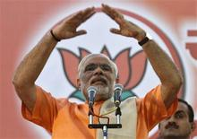 Narendra Modi, chief minister of Gujarat state, gestures as he addresses his supporters during a felicitation ceremony outside the party office in the western Indian city of Ahmedabad December 20, 2012. REUTERS/Amit Dave