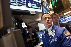 Traders work the floor at the New York Stock Exchange in New York December 20, 2012. IntercontinentalExchange agreed a $8 billion deal to buy New York Stock Exchange owner NYSE Euronext on Thursday, propelling the commodities player into the big league of European derivatives and helping it to take on arch rival CME Group. REUTERS/Andrew Kelly