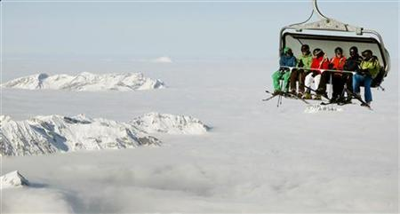 Skiers sit in a chairlift at the Mount Titlis (3,238 m/10,623 ft) skiing area near the Swiss mountain resort of Engelberg December 1, 2012. REUTERS/Arnd Wiegmann