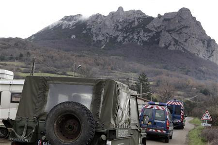 French gendarmes drive on a road in Bugarach in order to secure the area around the peak, December 19, 2012. The Peak of Bugarach, the highest point of the Corbieres massif, in southwestern France and surrounded in legend for centuries, has become a focal point for many Apocalypse believers as rumours have circulated that its mountain contains doors into other worlds, or that extraterrestrials will return here on Judgment day to take refuge at their base. Residents of the tiny southern French hamlet, are witness to a rising influx of Doomsday believers convinced it is the only place that will survive judgment day, December 21, 2012, as an era closes in the Maya Long Count calendar. REUTERS/Jean-Philippe Arles