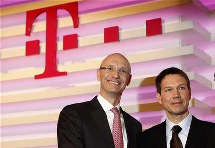 File picture shows designated new finance chief Timotheus Hoettges (L) and Rene Obermann, CEO of Deutsche Telekom AG before the annual news conference in Bonn February 27, 2009. Deutsche Telekom Chief Executive Rene Obermann is stepping down at the end of next year and will be replaced by his finance chief Timotheus Hoettges, Deutsche Telekom said on December 20, 2012. Picture taken February 27, 2009. REUTERS/Ina Fassbender/File