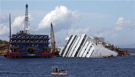 The capsized cruise liner Costa Concordia is seen surrounded by cranes during rescue operation in front of Giglio harbour November 6, 2012. REUTERS/ Stefano Rellandini