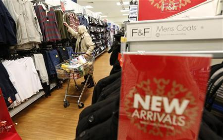 A customer shops for clothing at a Tesco shop in Bishop's Stortford, southern England November 26, 2012. REUTERS/Suzanne Plunkett