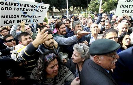 Angry demonstrators protest as lawmakers discuss new austerity laws in Cyprus' parliament, December 12, 2012. REUTERS/Andreas Manolis