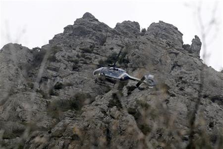 French gendarmes use a helicopter to secure the area to the peak in Bugarach, December 19, 2012. REUTERS/Jean-Philippe Arles