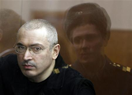 Jailed Russian former oil tycoon Mikhail Khodorkovsky stands in the defendants' cage during a court session in Moscow in this April 5, 2010 file photograph. REUTERS/Grigory Dukor