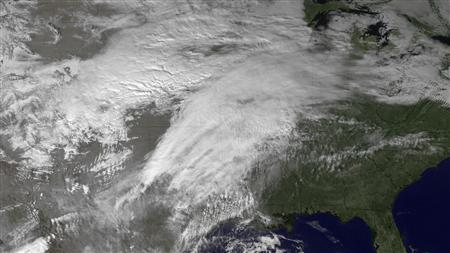 A satellite image shows blizzard-like conditions over the central Plains, December 19, 2012. REUTERS/NOAA