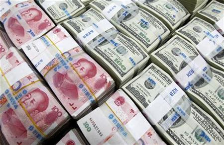 U.S. dollar and Yuan notes are seen in this picture illustration taken at the Korea Exchange Bank in Seoul November 10, 2010. REUTERS/Lee Jae-won/Files