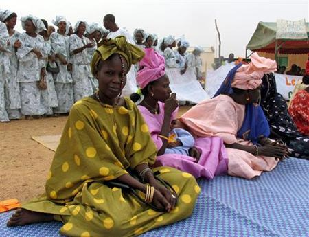 Senegalese women from different villages take part at a declaration against female genital mutilation or cutting in Matam, northern Senegal in this picture released by UNICEF on November 24, 2005. REUTERS/Sarah Crowe/UNICEF/Handout/Files