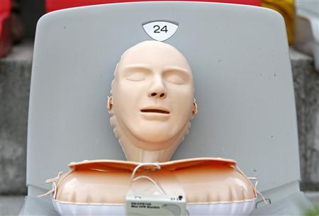 A plastic CPR training mannequin is seen as Romanian volunteers learn how to save lives by practicing CPR on 700 plastic models, in an attempt to enter the Guinness Book of World Records, at Dinamo stadium in Bucharest July 26, 2011. REUTERS/Bogdan Cristel