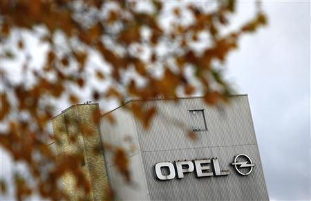 Leaves of a tree are pictured in front of a factory building with a logo of German car manufacturer Opel at the headquarters in Ruesselsheim November 12, 2012. REUTERS/Lisi Niesner