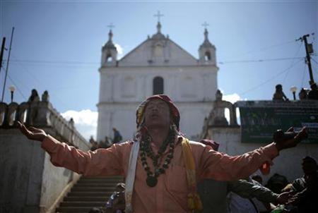 Carlos Tun, a Mayan priest, prays and participates in the pre-Hispanic mass of ''Primera Conexion'' and ''Sincronizacion Espiritual'' (First Connection and Spiritual Synchronization), to commemorate the 13th Baktun, outside the Chi Ixim church in Tactic, Alta Verapaz region, December 20, 2012. This week, at sunrise on Friday, December 21, an era closes in the Maya Long Count calendar, an event that has been likened by different groups to the end of days, the start of a new, more spiritual age or a good reason to hang out at old Maya temples across Mexico and Central America. The Chi Ixim church is a sacred Mayan site. REUTERS/Jorge Dan Lopez