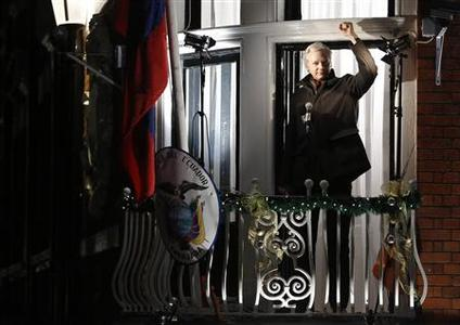 WikiLeaks founder Julian Assange gestures from the balcony of Ecuador's Embassy as he makes a speech, in central London December 20, 2012. REUTERS/Luke MacGregor